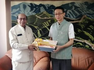 Consul General Guocai Tang (right) with Dr. G.H.Fernandes, President of ICFA
